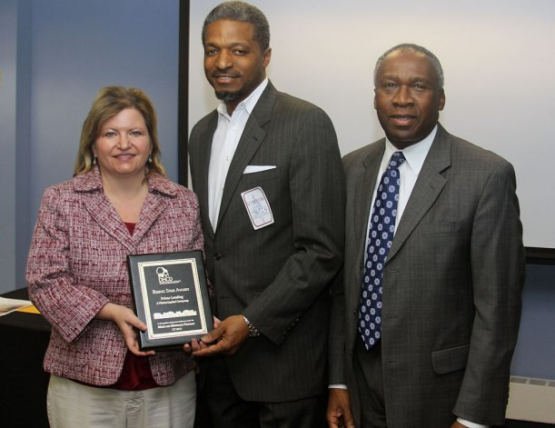 Secretary Skinner presents the 2013 Maryland Mortgage Program Rising Star Award to Brenda Spaulding and Gene Frazier of PrimeLending.