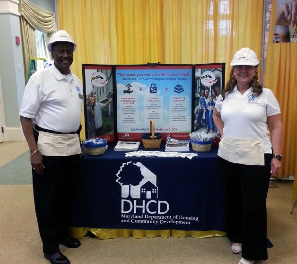 DHCD's Edward Anthony and Catherine Kraemer-Dale spread the word about the Maryland Mortgage Program at the Harford County Realtor Expo Wednesday in Bulle Rock, Md.