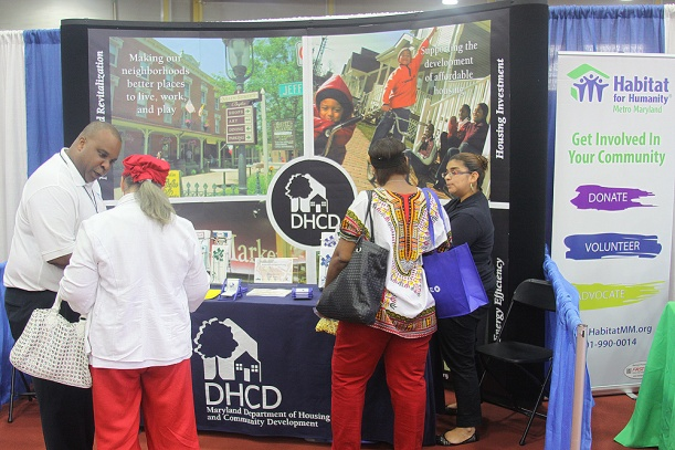 Homeowners found lots of empowering information at a DHCD exhibit booth in June.