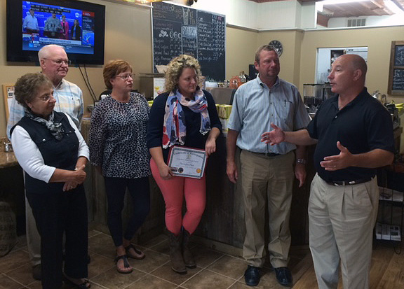 Elkton Mayor Robert J. Alt, far right, meets with the owners of The Coffee Place as the town's historic downtown business district commemorates Economic Development Week.