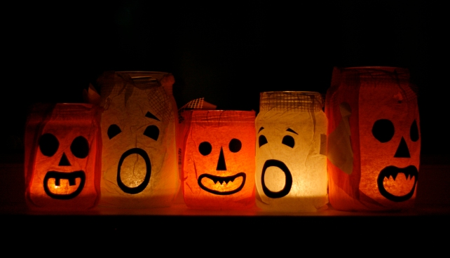 Have a green Halloween! Set the mood for a spooky atmosphere by using LED lightbulbs and candles to decorate your home (Photo by: FreeImages.com/kasiakay).